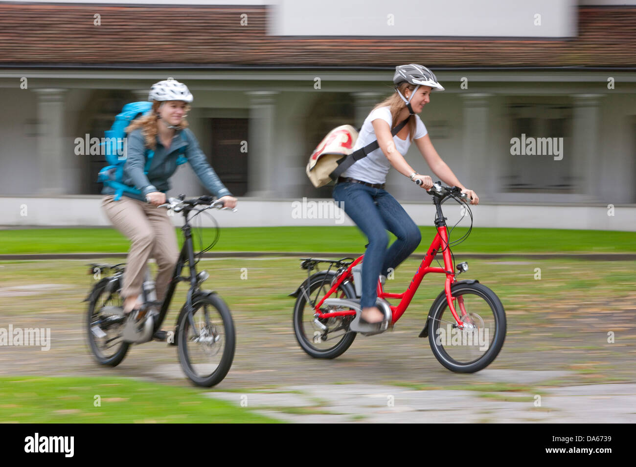 Students, electric bicycle, Flyer, eBike, bicycle, bicycles, bike, riding a bicycle, Switzerland, Europe, women, - Stock Image