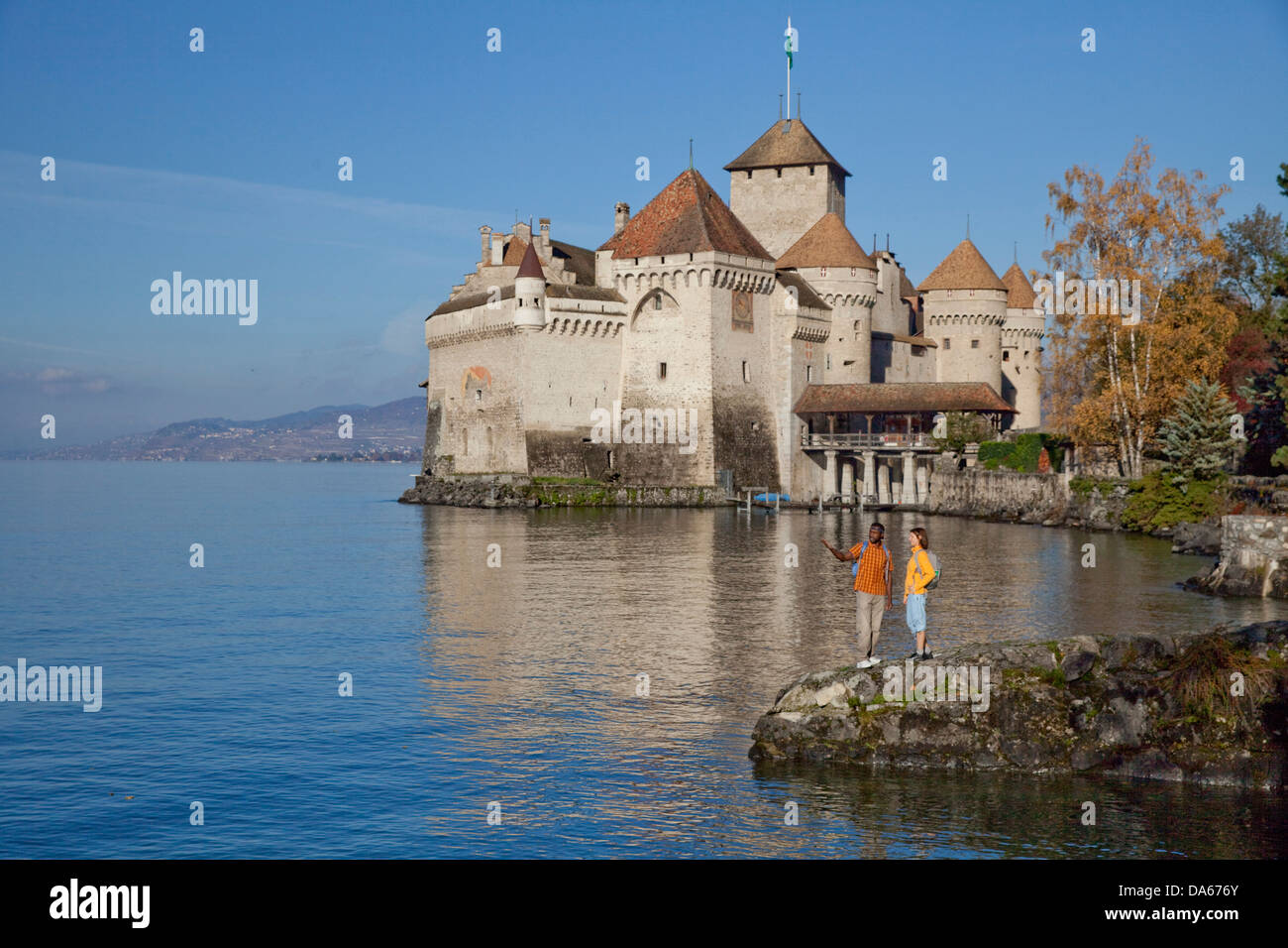 Traveller, Castle, Chillon, autumn, Castle, lake, lakes, canton, VD, Vaud, lake Geneva, Lac Leman, footpath, walking, - Stock Image