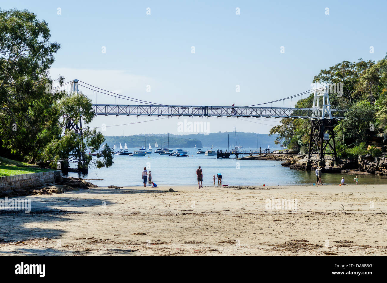 Parsley Bay in Sydney with its cove, pedestrian bridge, beach and lawned reserve. - Stock Image