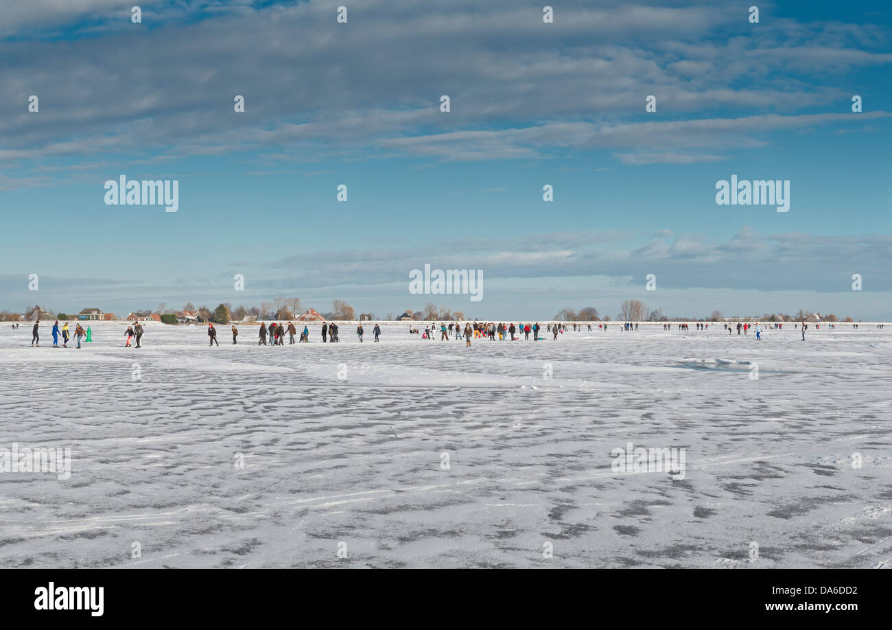 Holland, Netherlands, Europe, Monnickendam, Skaters, frozen, Gouwzee, landscape, water, winter, snow, ice, people, - Stock Image