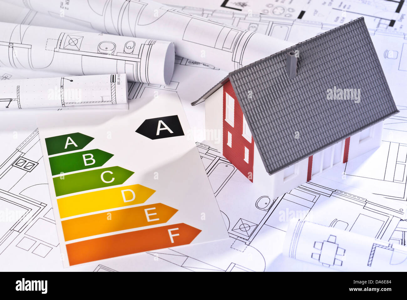 Energy efficiency labels, architectural model and blueprints. - Stock Image