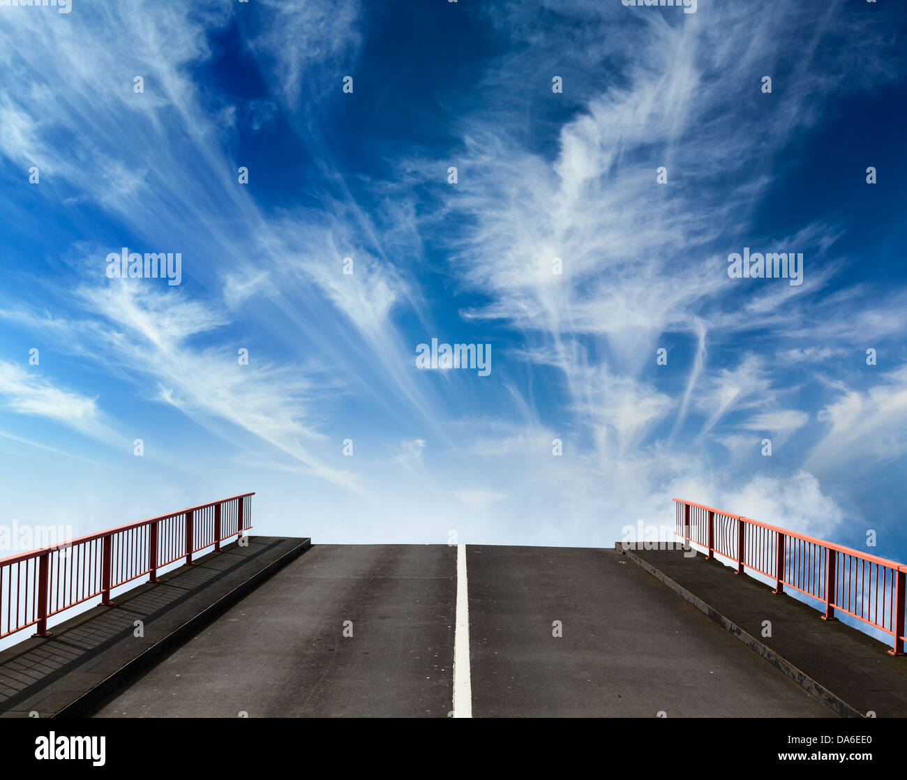 Asphalt road going into sky with clouds - Stock Image