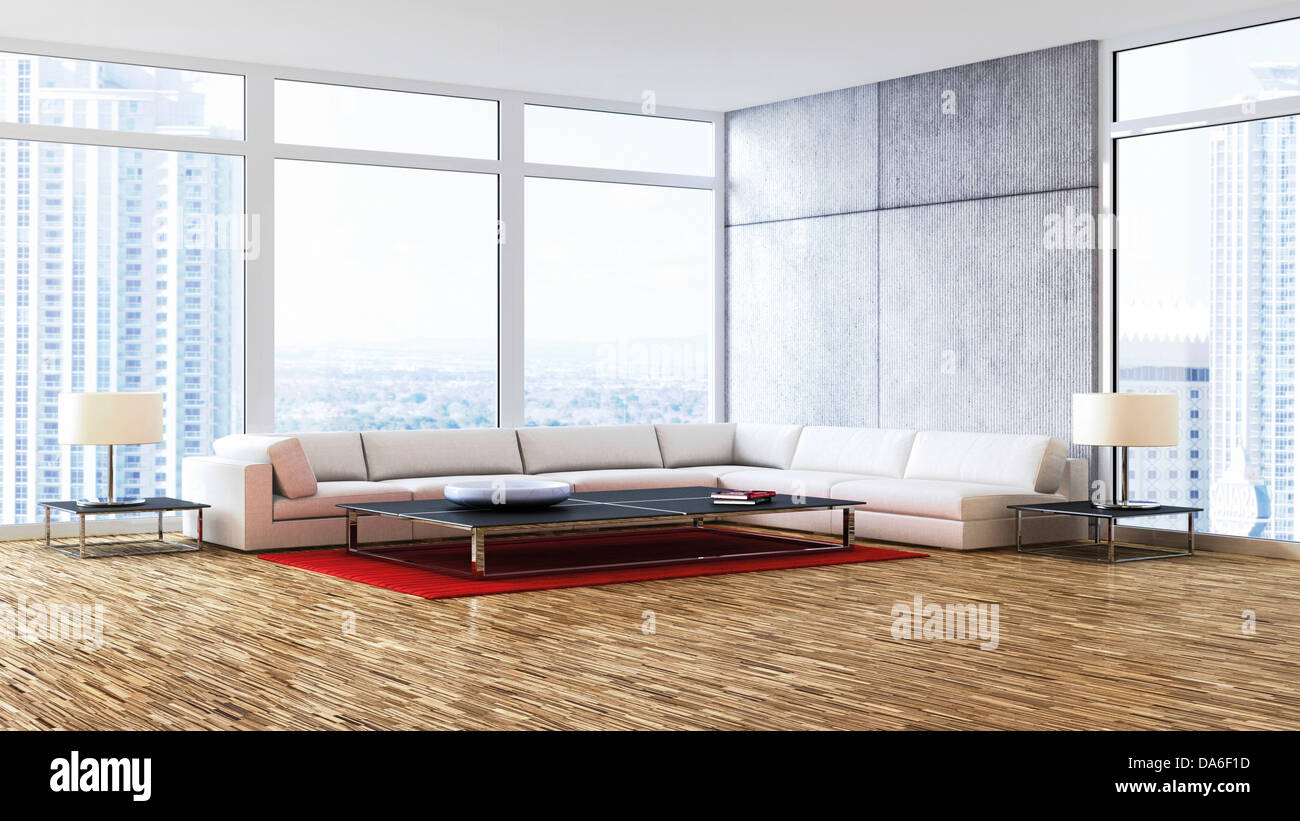 Living room with a corner lounge seating area in front of the windows Stock Photo