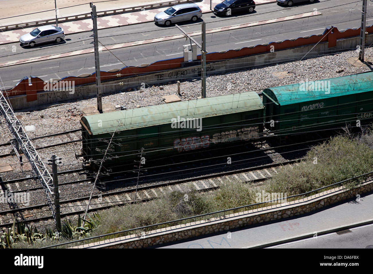 old goods carriages on spanish electric electrified railway line lines tarragona catalonia spain - Stock Image