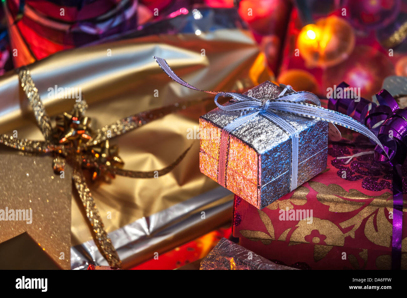 A small silver wrapped box with other Christmas gifts with fairy ...