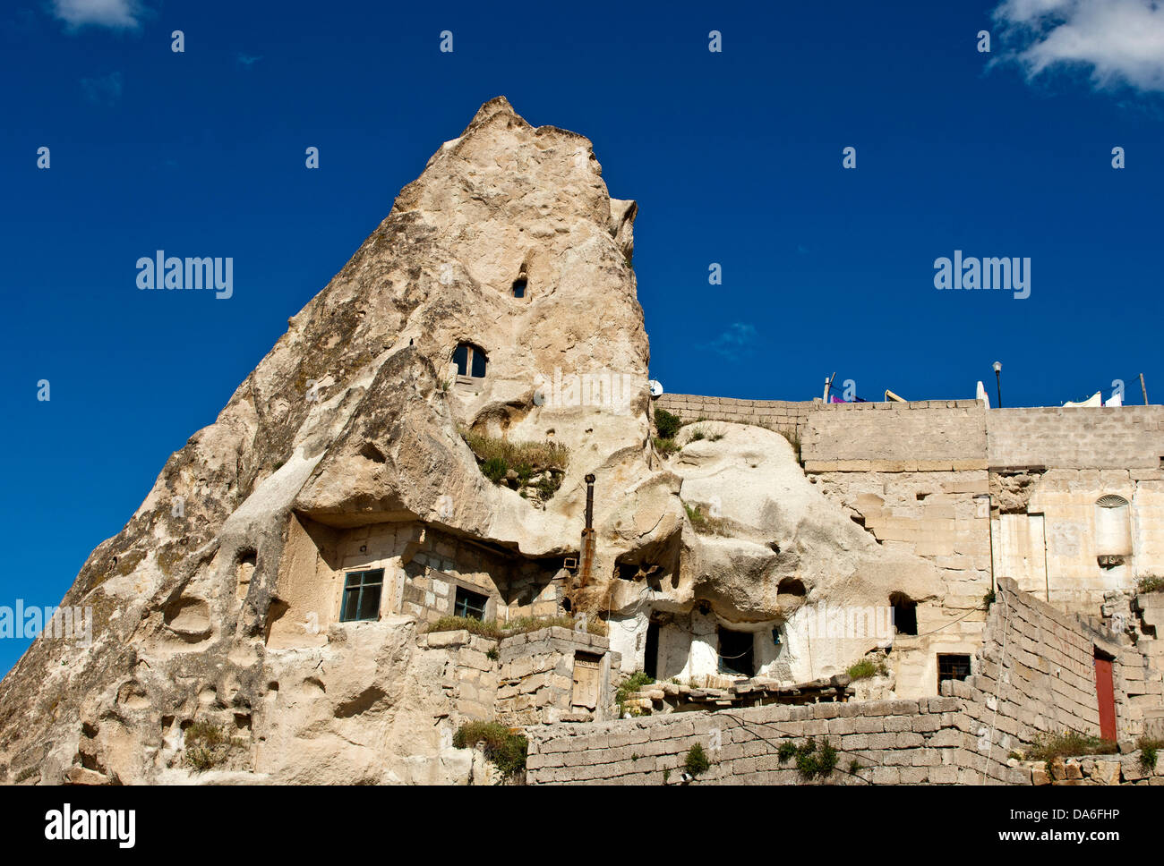 Cave dwellings in hollowed tuff rock - Stock Image