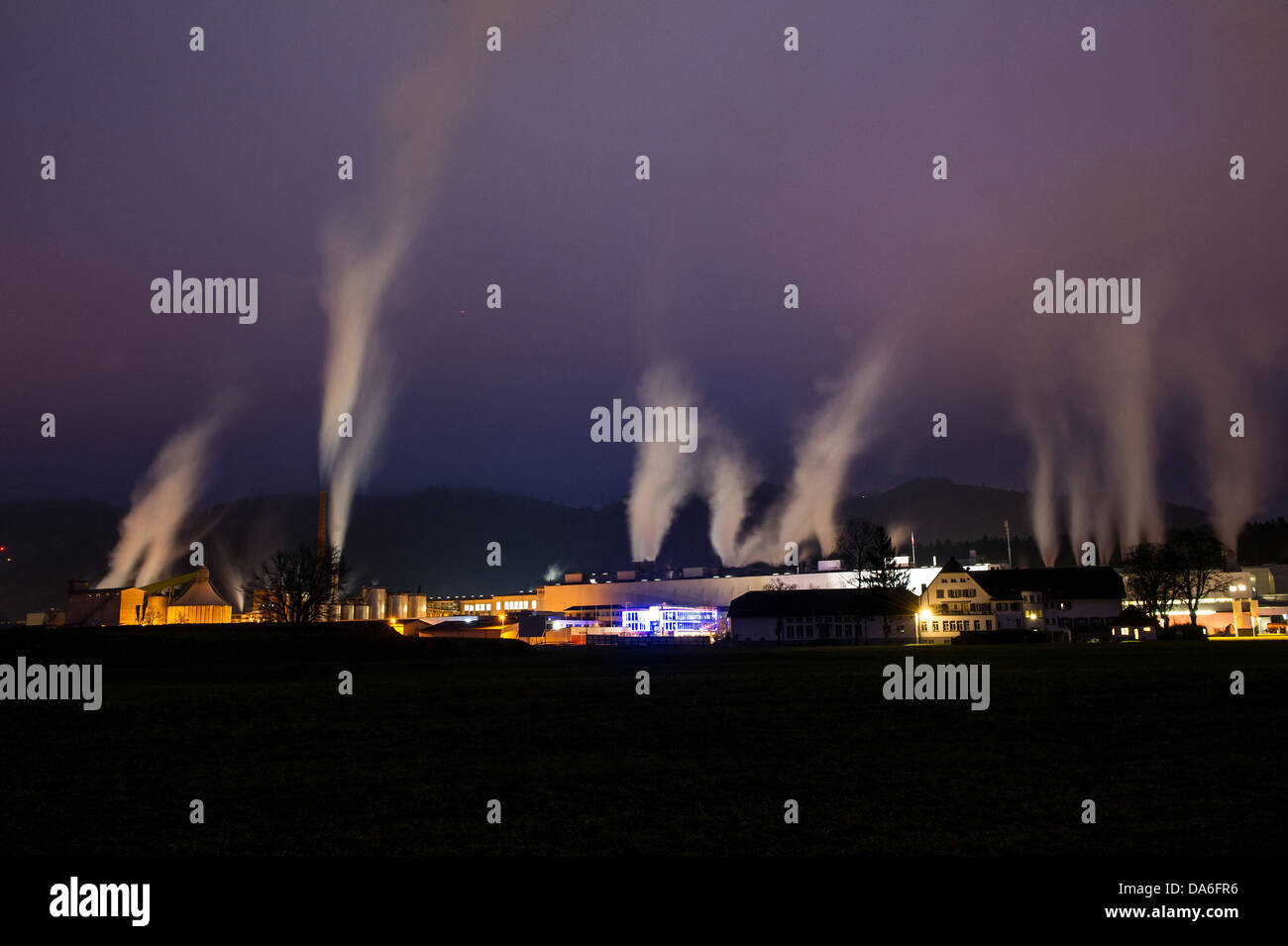 Factory, smoke, chimney, exhaust gases, production, at night, light, paper factory, ecology, CO2, industry - Stock Image