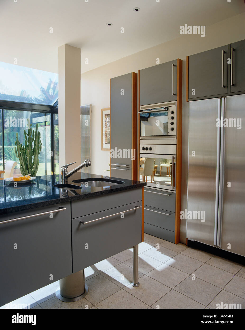 Sink Set In Central Island Unit In Contemporary Kitchen With