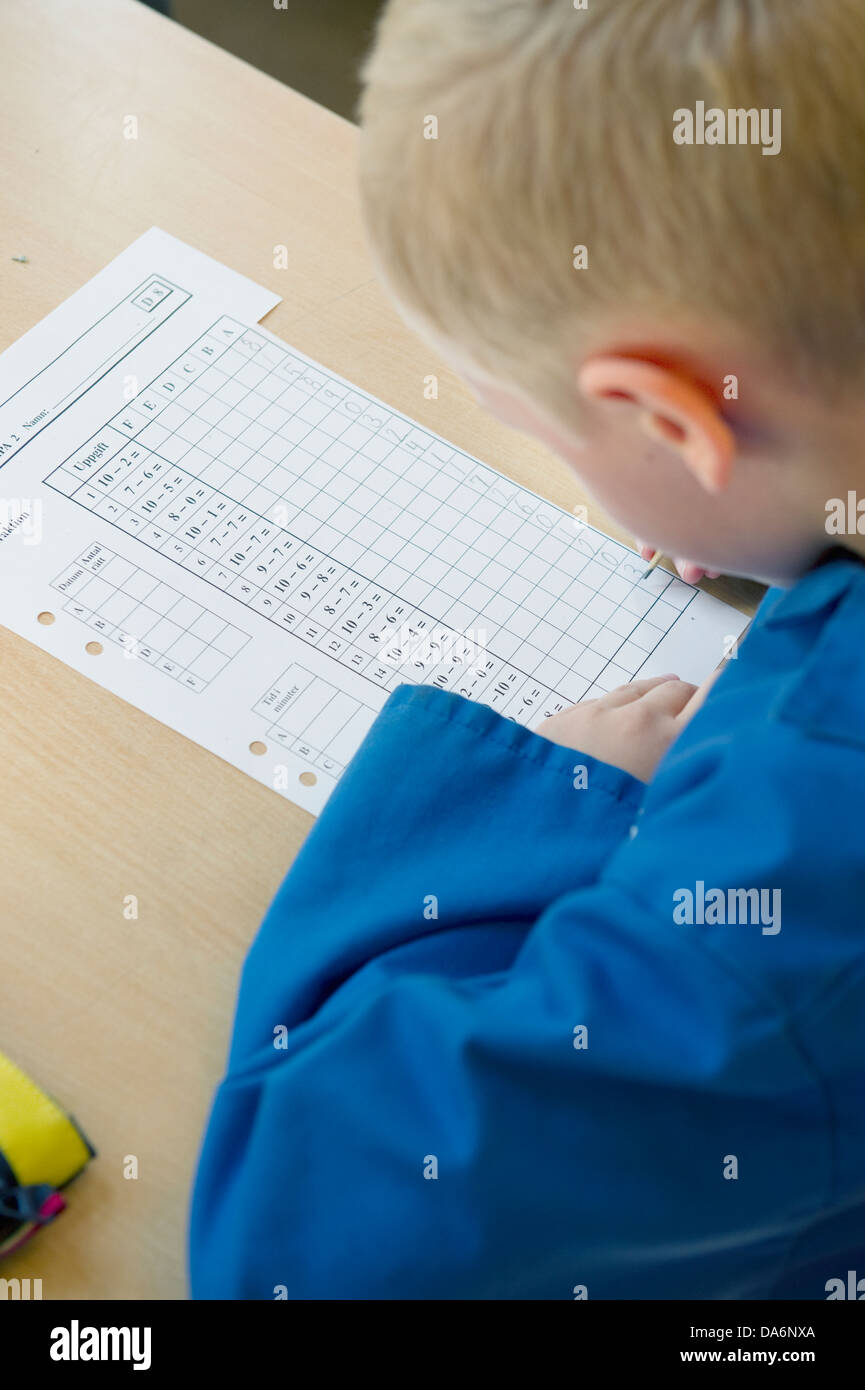 View of schoolboy (8-9) writting - Stock Image