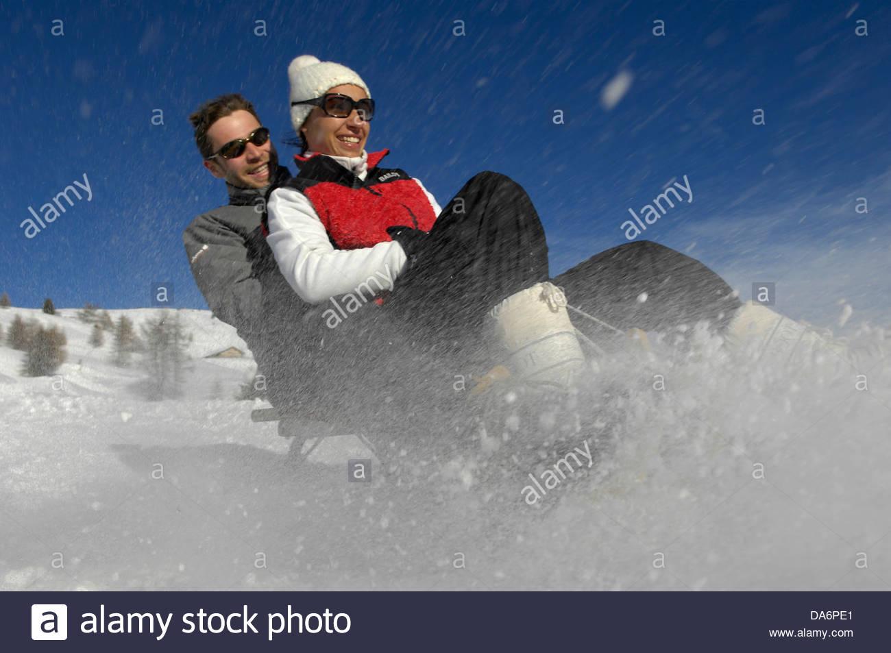 couple with a sledge,tyrol - Stock Image