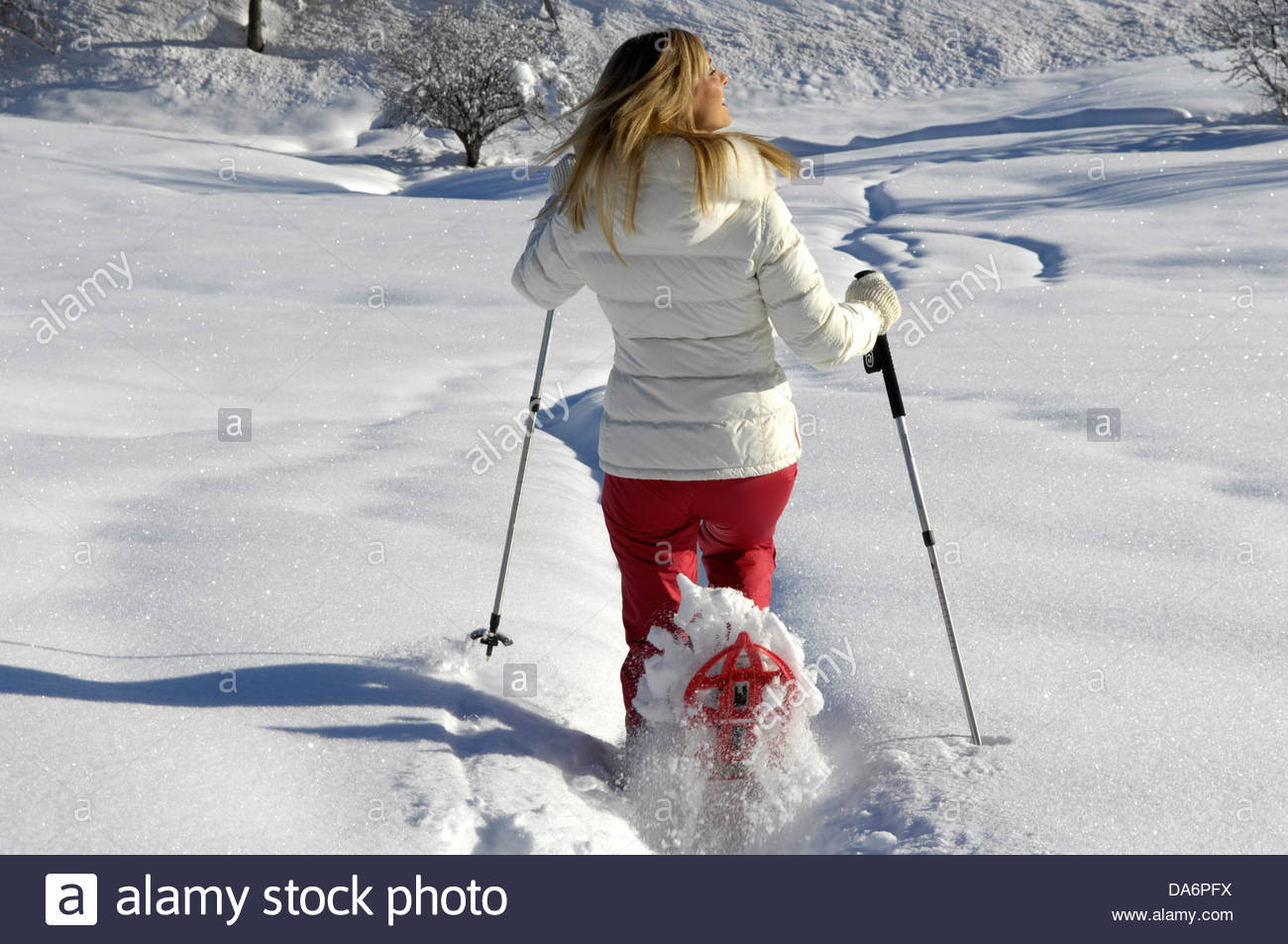 woman with snowshoes on the snow,south tyrol - Stock Image
