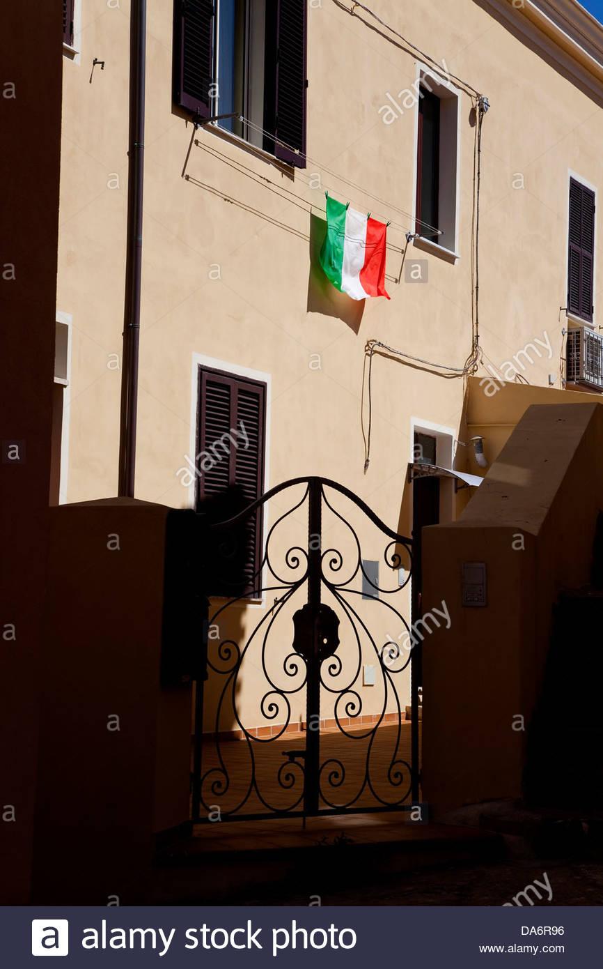Italian flag and home,La Maddalena,Sardinia,Italy - Stock Image