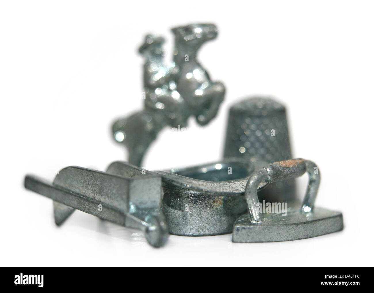 Monopoly game pieces. - Stock Image