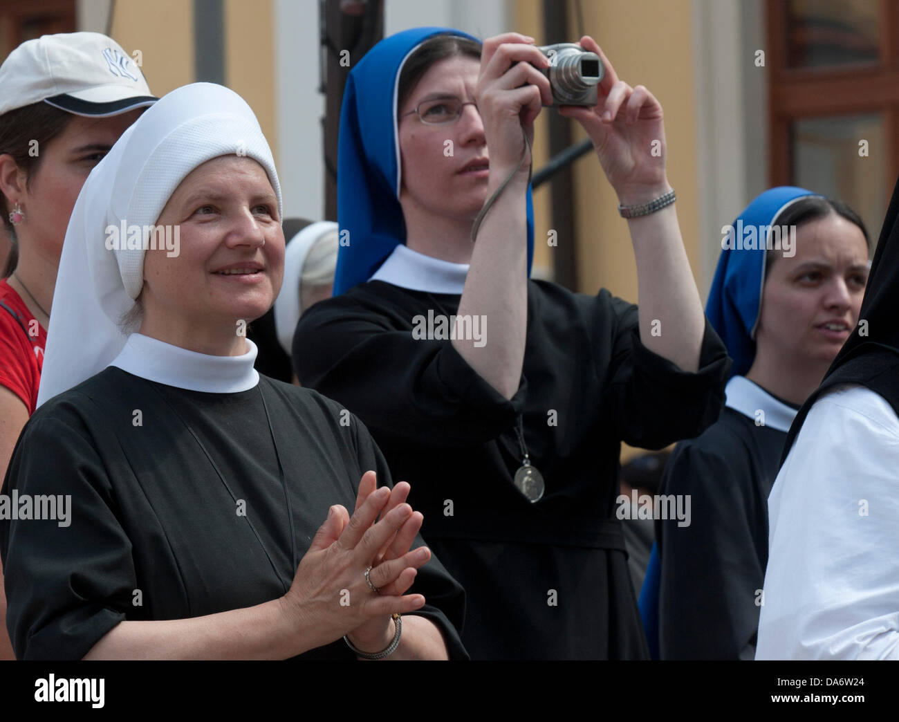 A nun takes pictures as thousands of pilgrims celebrate the 1150th anniversary of the arrival of Cyril and Methodius, - Stock Image