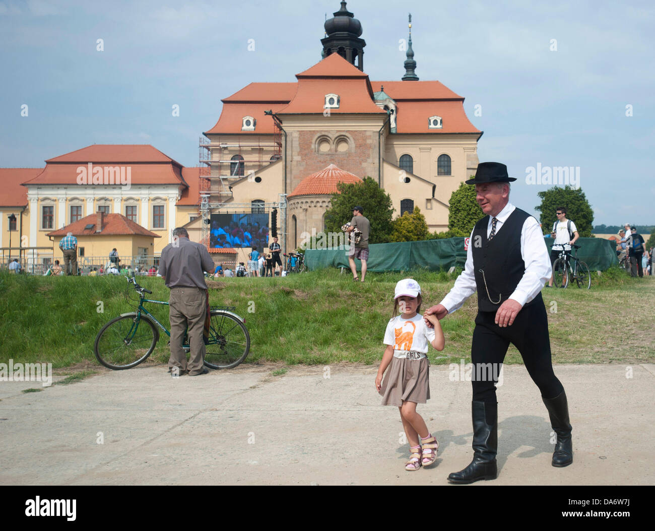 An old man with a little girl join thousands of pilgrims celebrating the 1150th anniversary of the arrival of Cyril - Stock Image