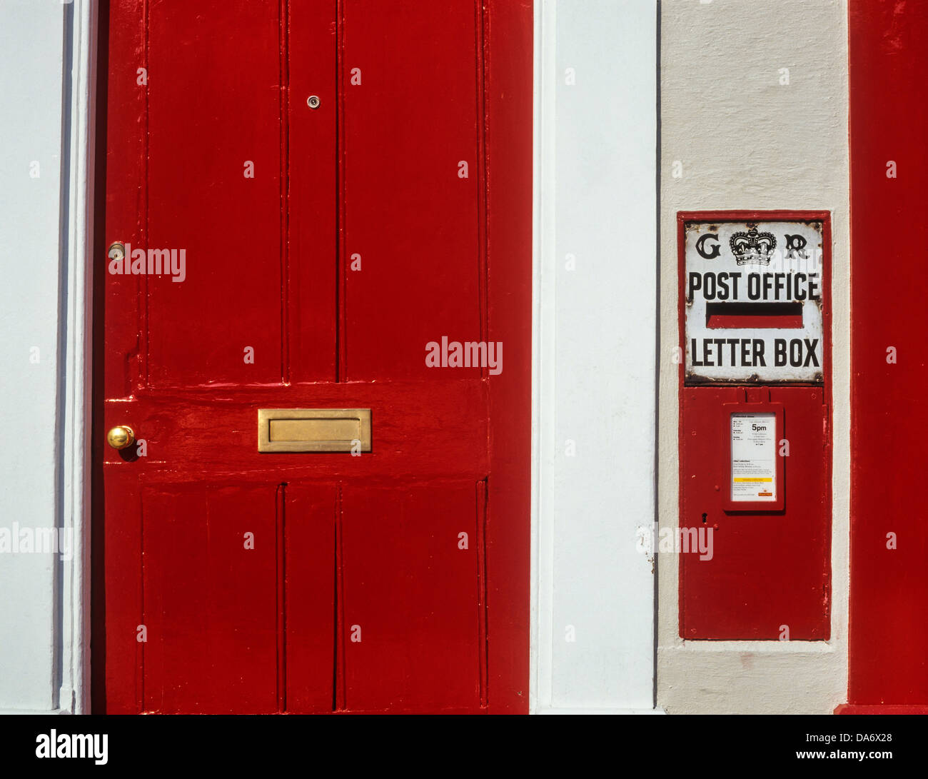 A red front door and letter box. Kimbolton, Huntingdonshire, Cambridge - Stock Image