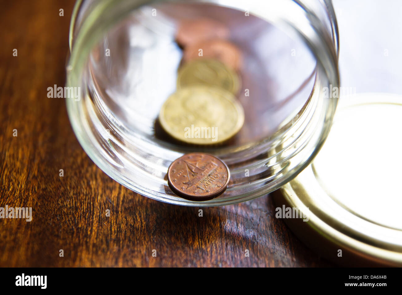 Economy of Greece is having hard times. This photo shows how Greek people collect their euro coins in jars - Stock Image