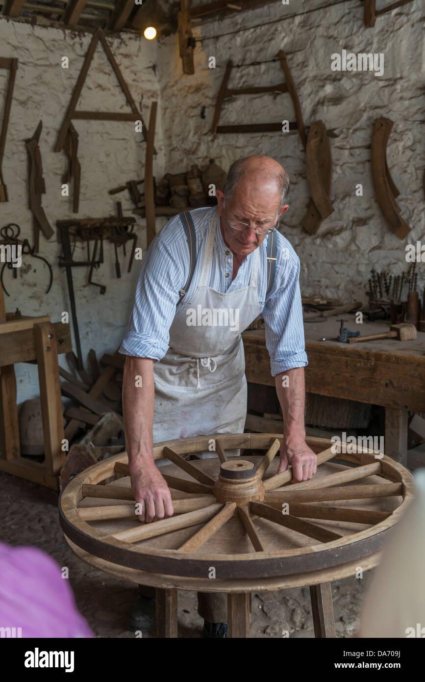 Wheelwright's demonstration at Acton Scott Historic Working Farm. Shropshire - Stock Image
