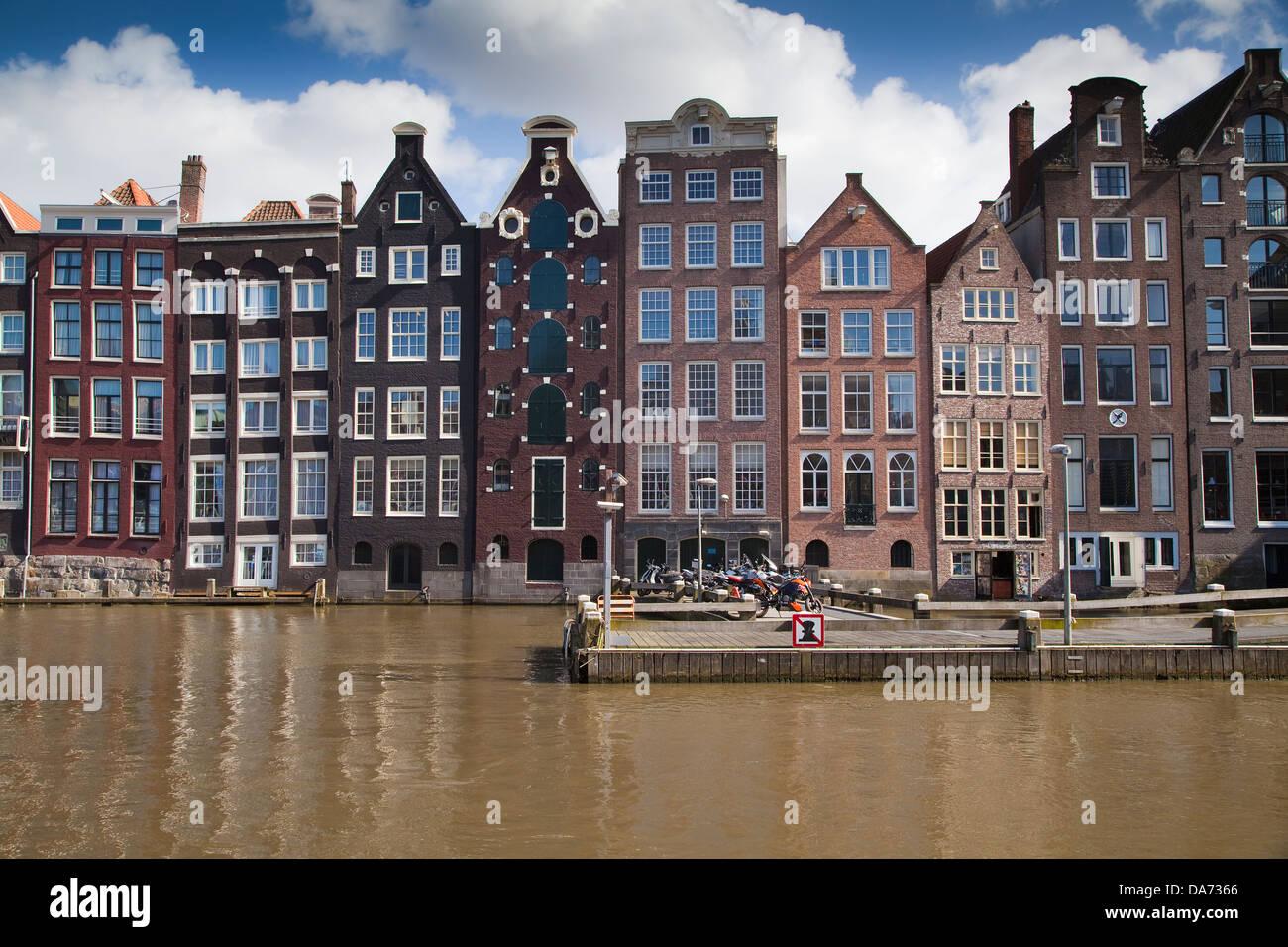 Europe, Netherlands,North Holland,Amsterdam,Damrak,typical dutch houses - Stock Image