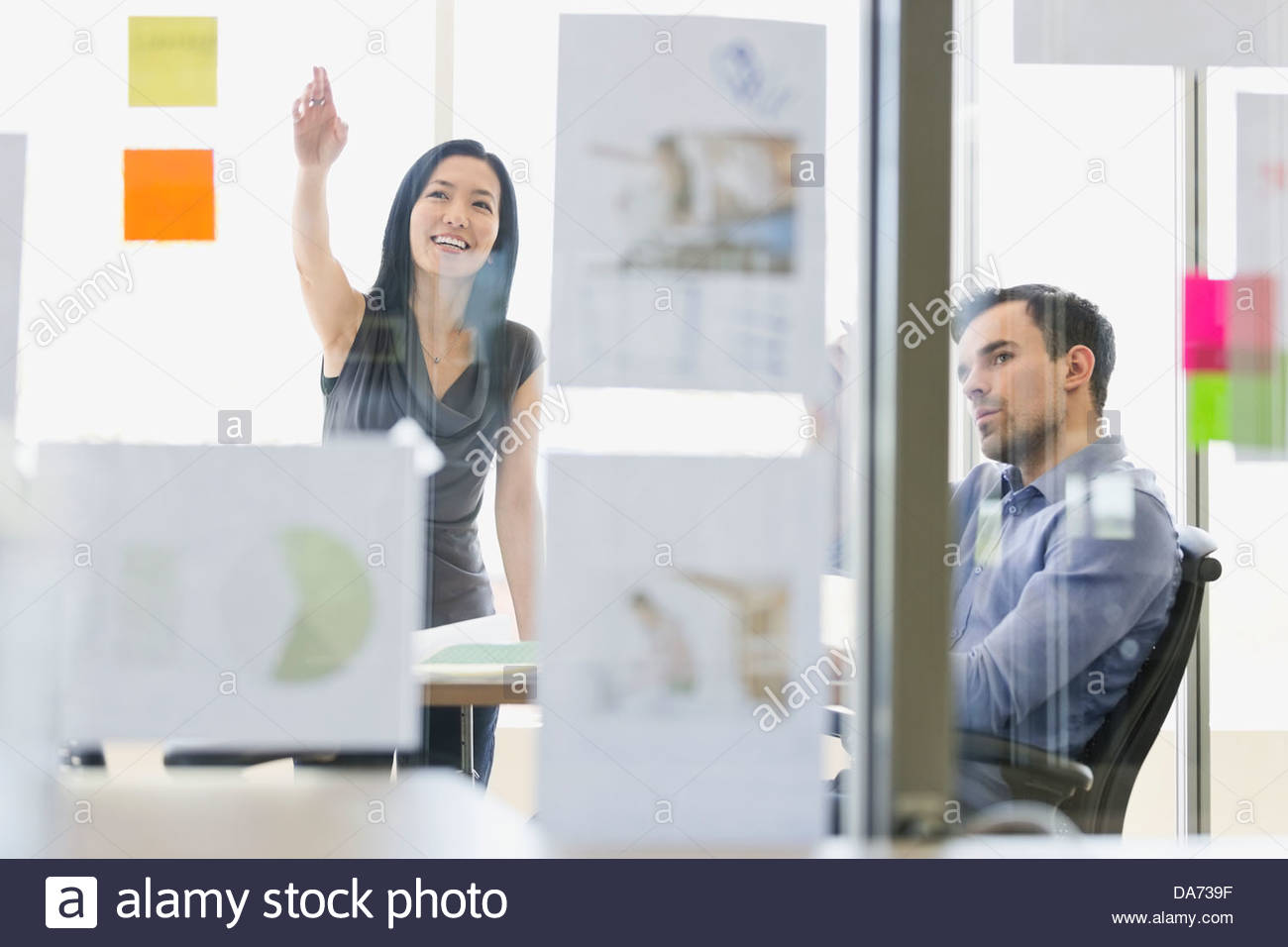 Business people discussing project in office - Stock Image