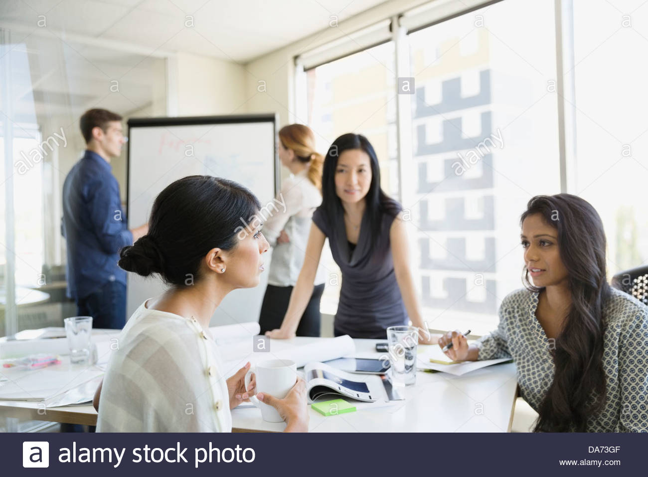 Business colleagues working on project in office - Stock Image