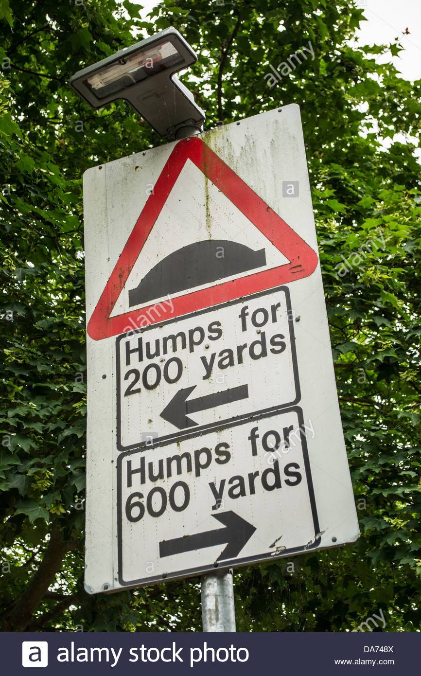 Sign indicating humps in the road both ways - Stock Image