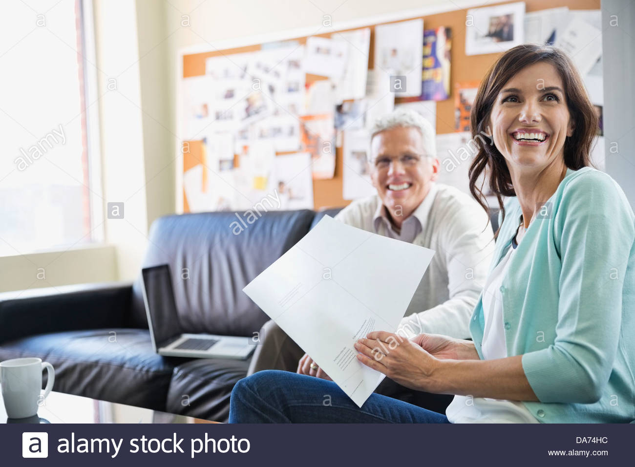 Business people working on project at table in office - Stock Image