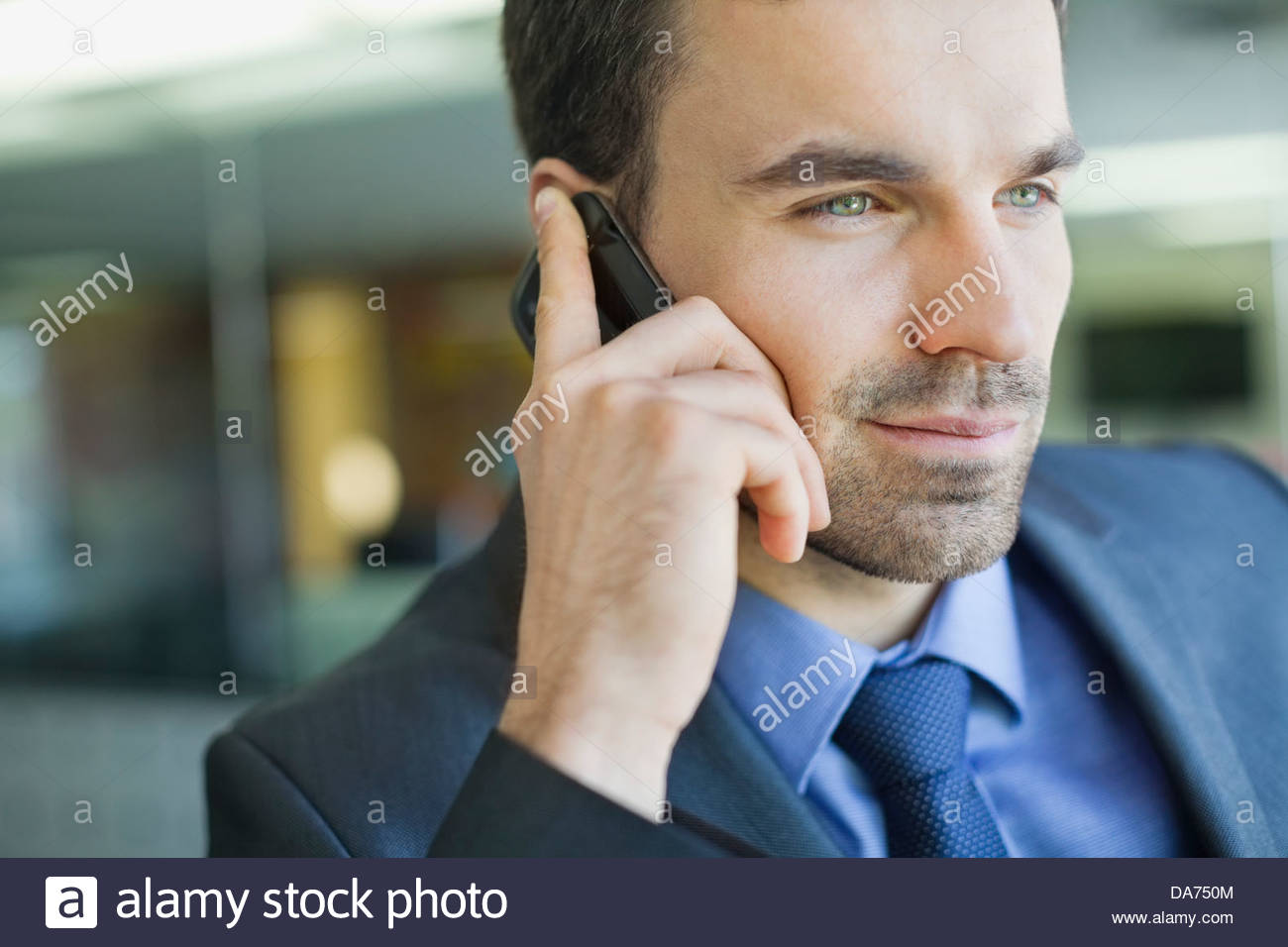 Close-up of businessman using mobile phone Stock Photo