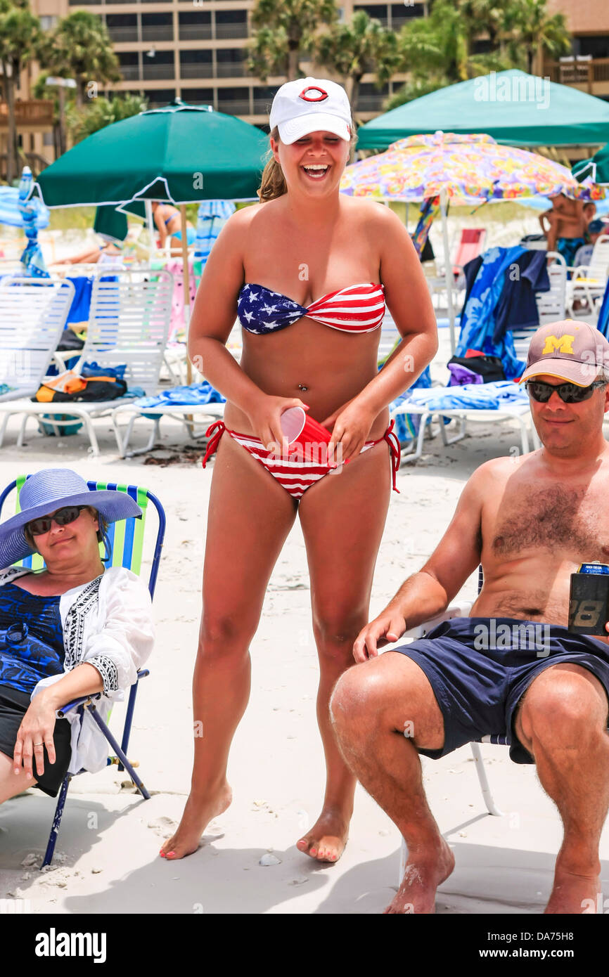 f38070ce3d Woman wears a patriotic Stars and Stripes bikini on July 4th at the beach  in Florida