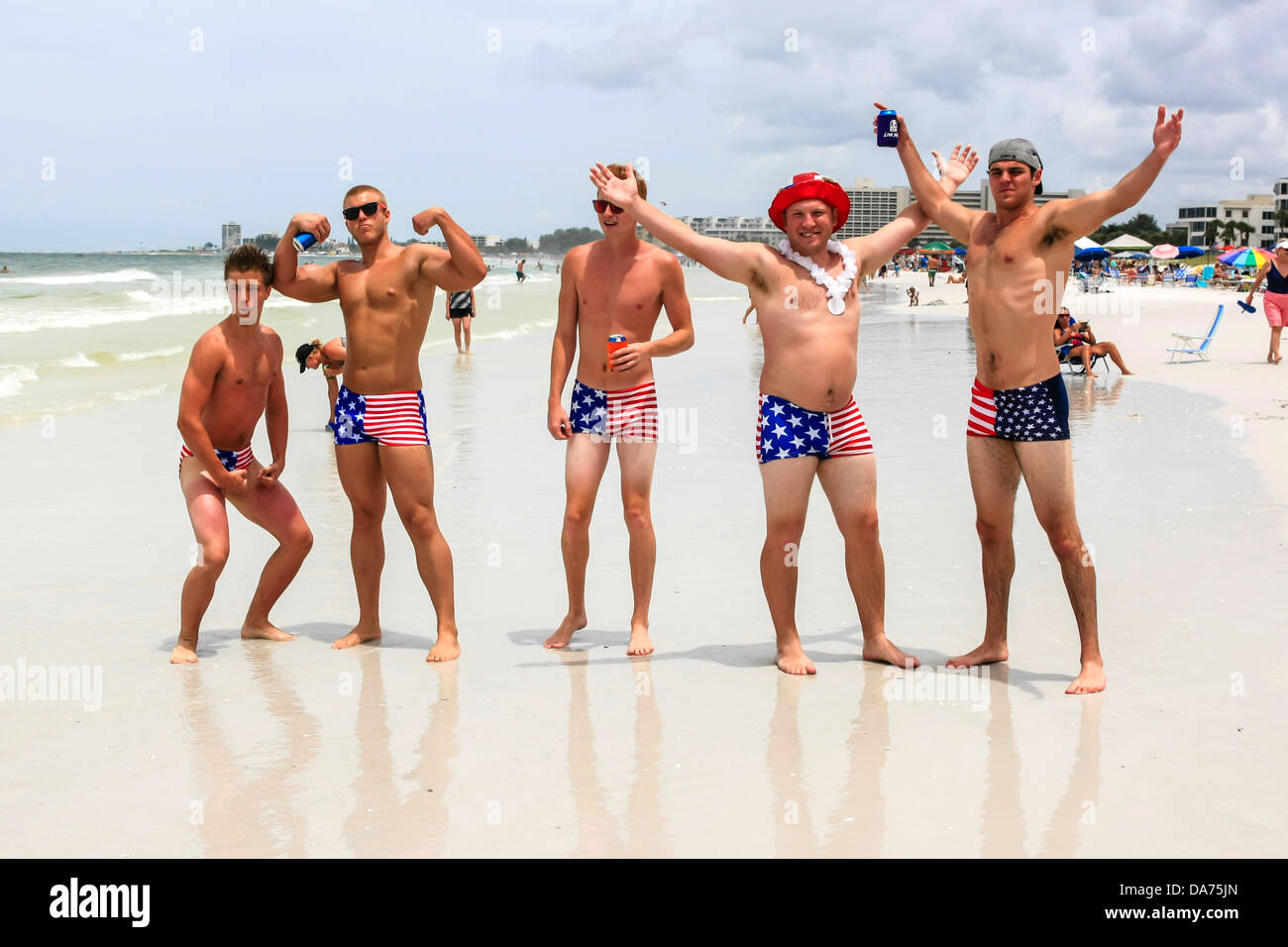 College guys wear patriotic Stars and Stripes swimwear on July 4th in Florida - Stock Image
