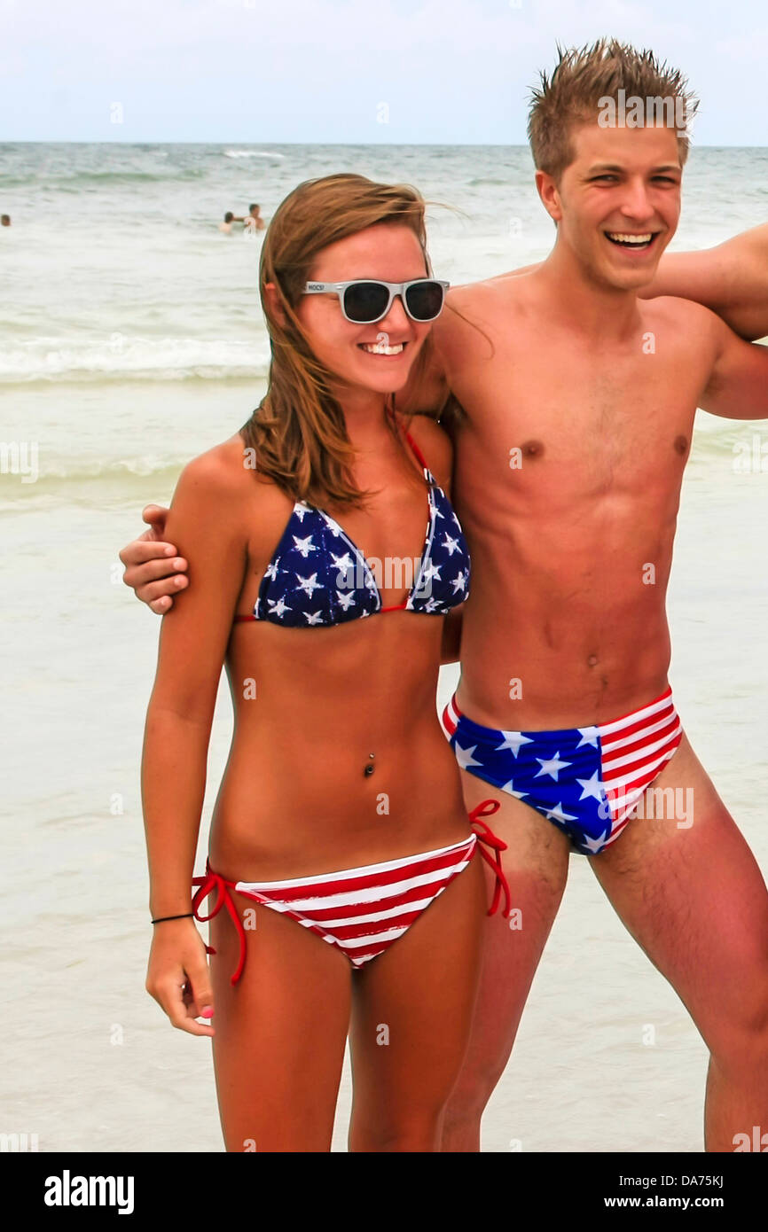 39b4349f45009 College guys and girls wear patriotic Stars and Stripes swimwear on July  4th in Florida