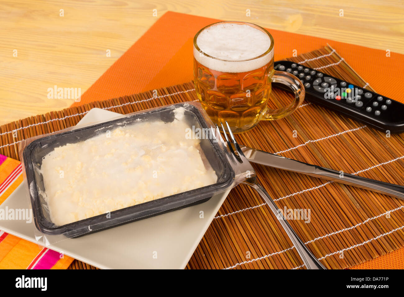 Still life with frozen food and a remote control, a concept - Stock Image