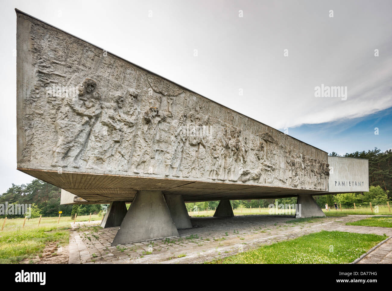 Wall of Remembrance memorial low reliefs at site of Nazi Kulmhof extermination camp near village of Chelmno nad - Stock Image