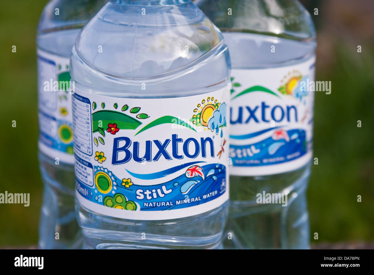 Close-up of three still natural mineral water bottles. Detail and focus on one label. - Stock Image