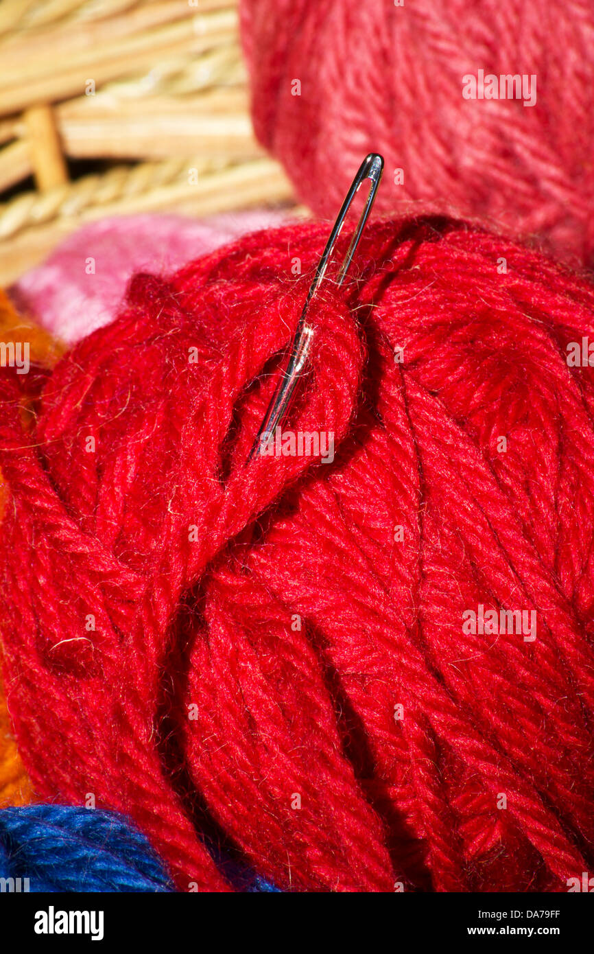 Needle on a skein of wool - Stock Image