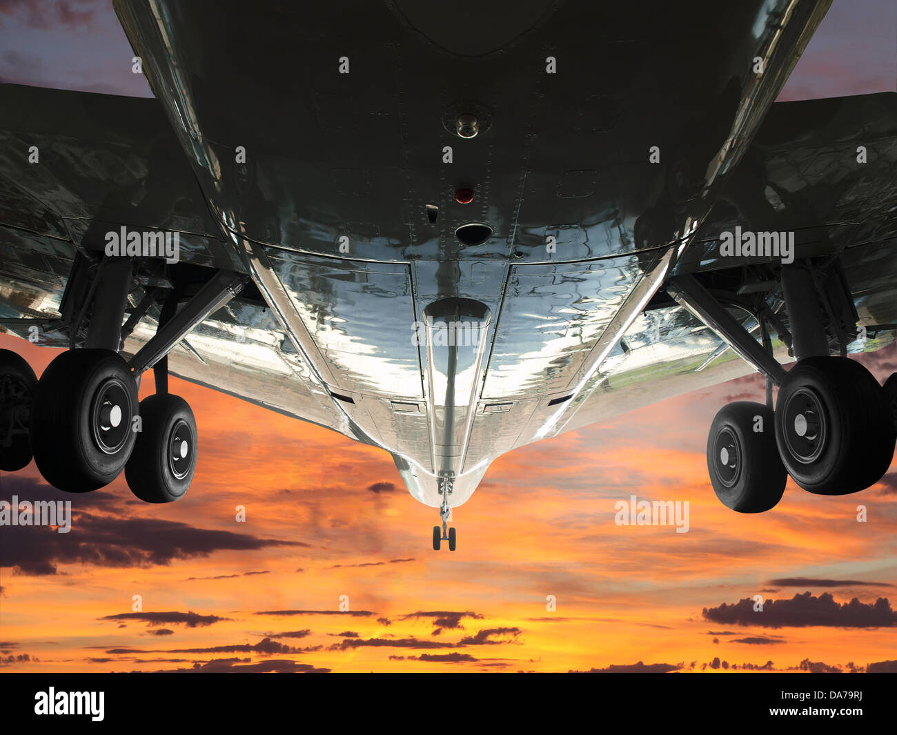 Jet lifting off into a sunrise sky. - Stock Image