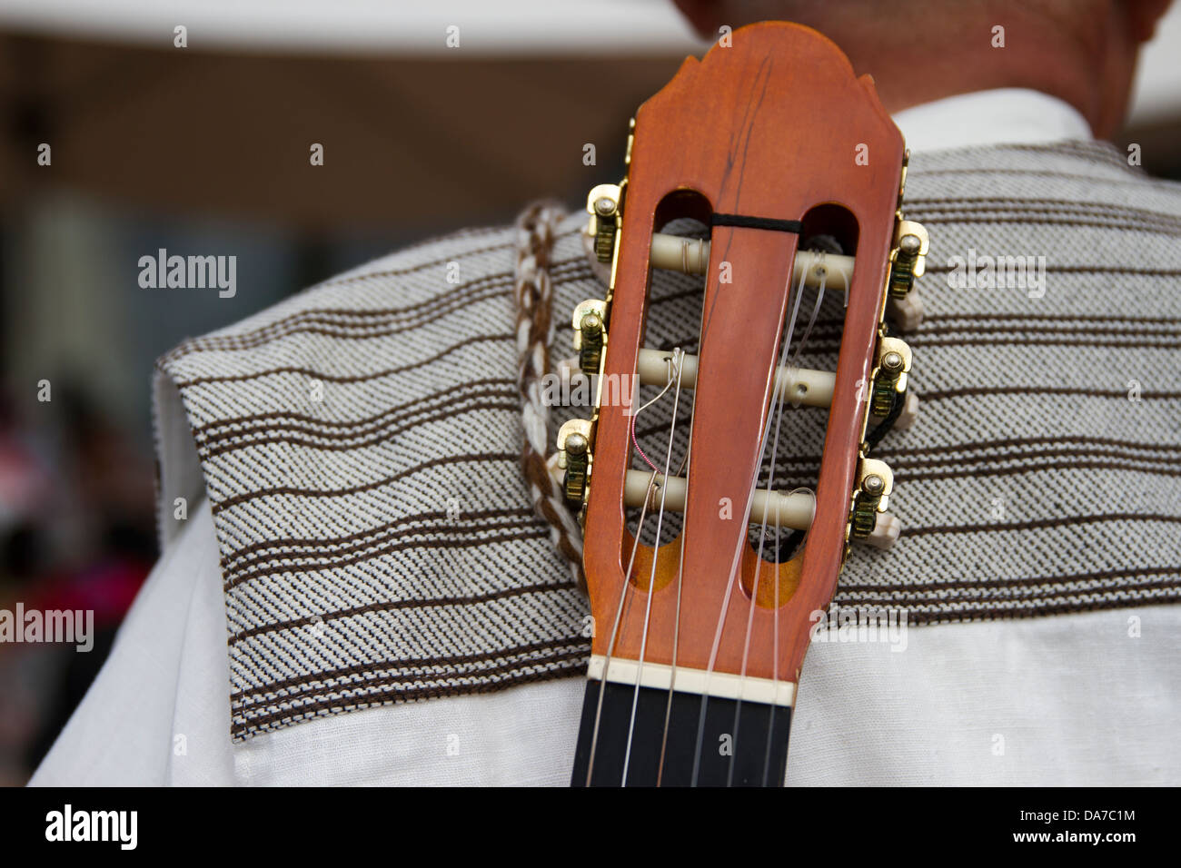 Folk Musicians with guitars on back - Stock Image