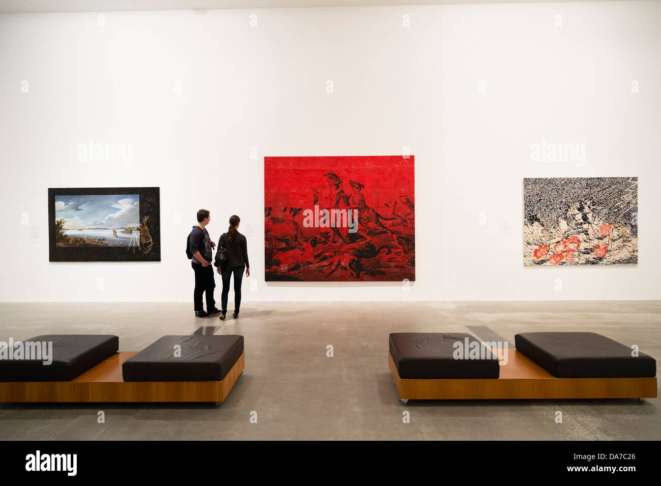 Visitors looking at paintings at Gallery of Modern Art or GoMA on Southbank n Brisbane Queensland Australia - Stock Image