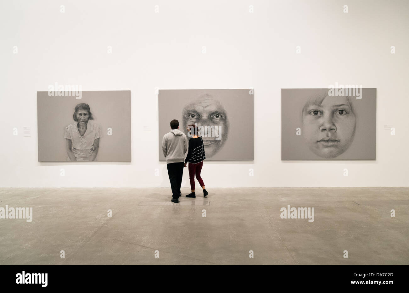 Visitors looking at paintings in Gallery of Modern Art or GoMA on Southbank n Brisbane Queensland Australia - Stock Image