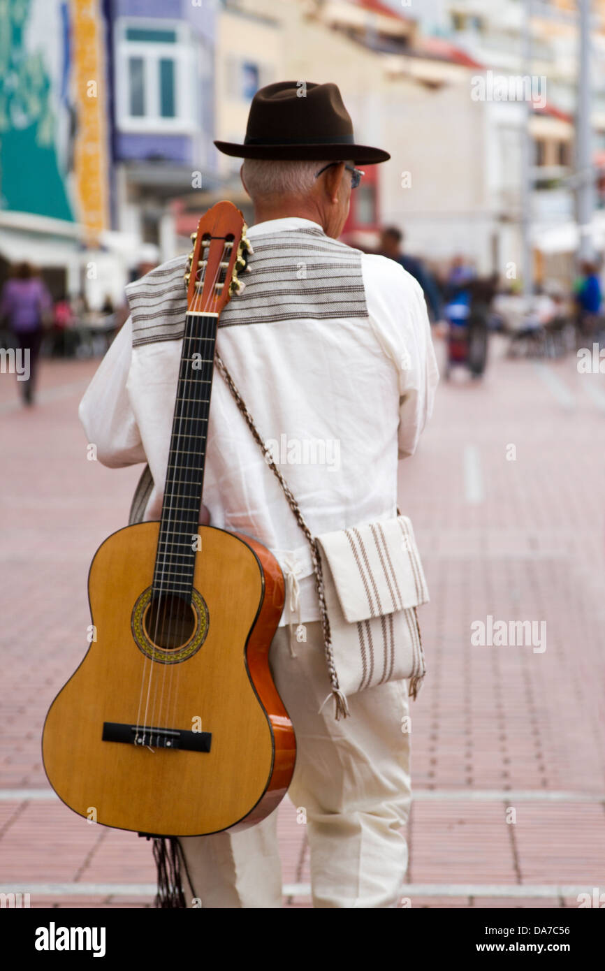 Folk Musicians with guitars on back Stock Photo
