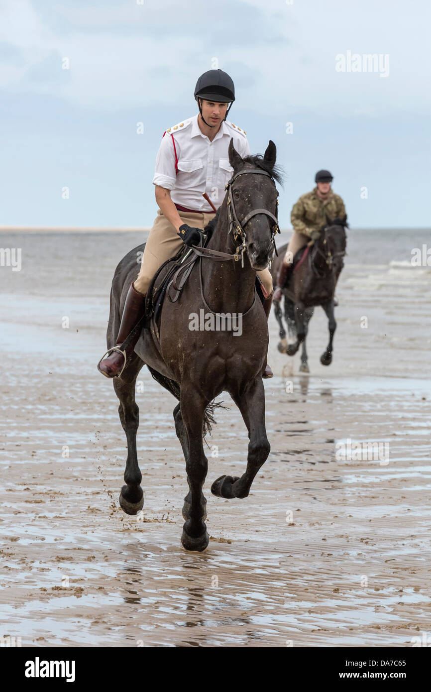 Holkham, Norfolk, UK. 4th July, 2013. The Household cavalry - Two members of the  Lifeguards riding on Holkham beach - Stock Image
