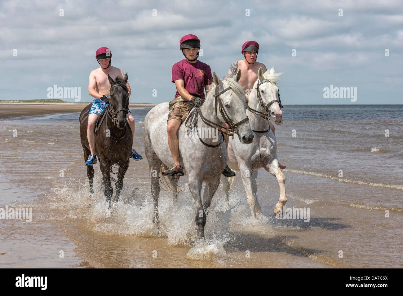 Holkham, Norfolk, UK. 4th July, 2013. The Household cavalry - Three members of the  Lifeguards riding on Holkham - Stock Image