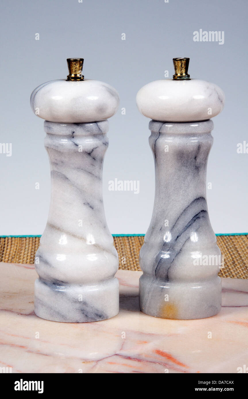 Marble salt and pepper pots. - Stock Image