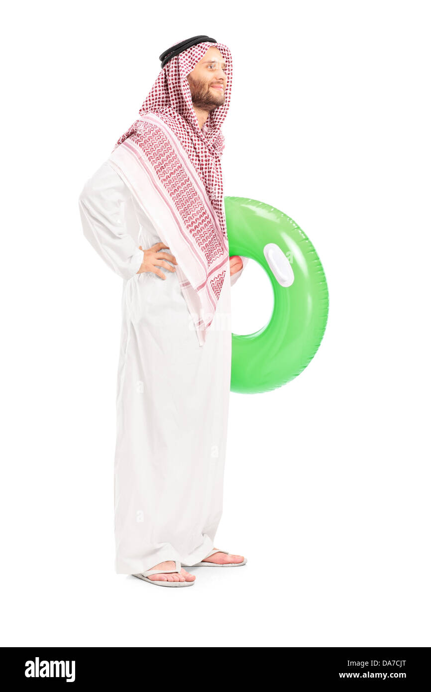 Full length portrait of a male arab person holding a swimming ring - Stock Image