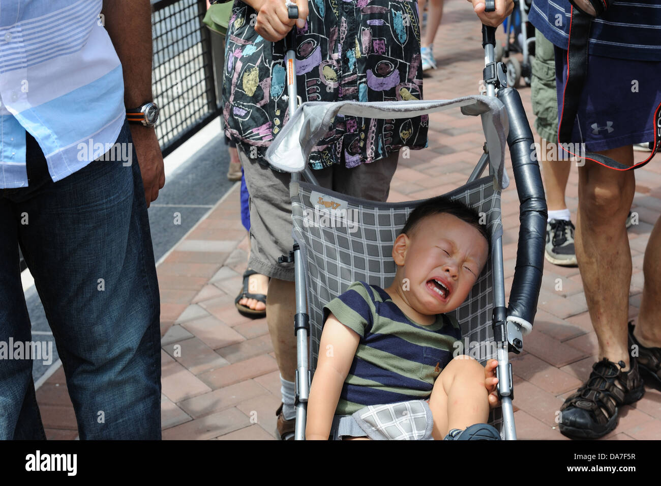 A crying child on Liberty Island in New York harbor. July 4, 2013 - Stock Image