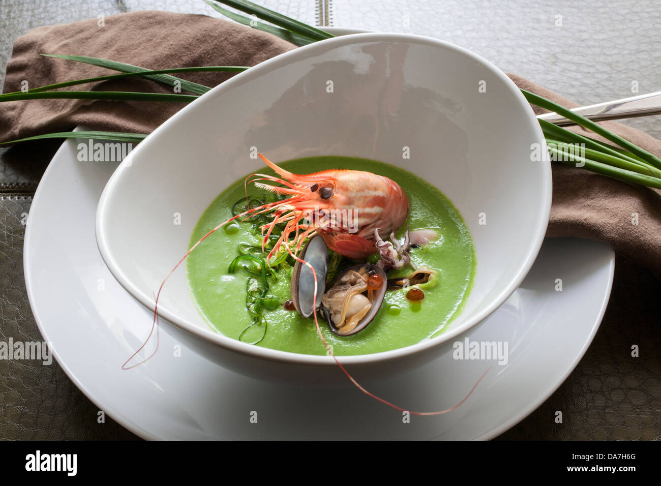 prawn seafood dish in a bowl shrimp soup - Stock Image