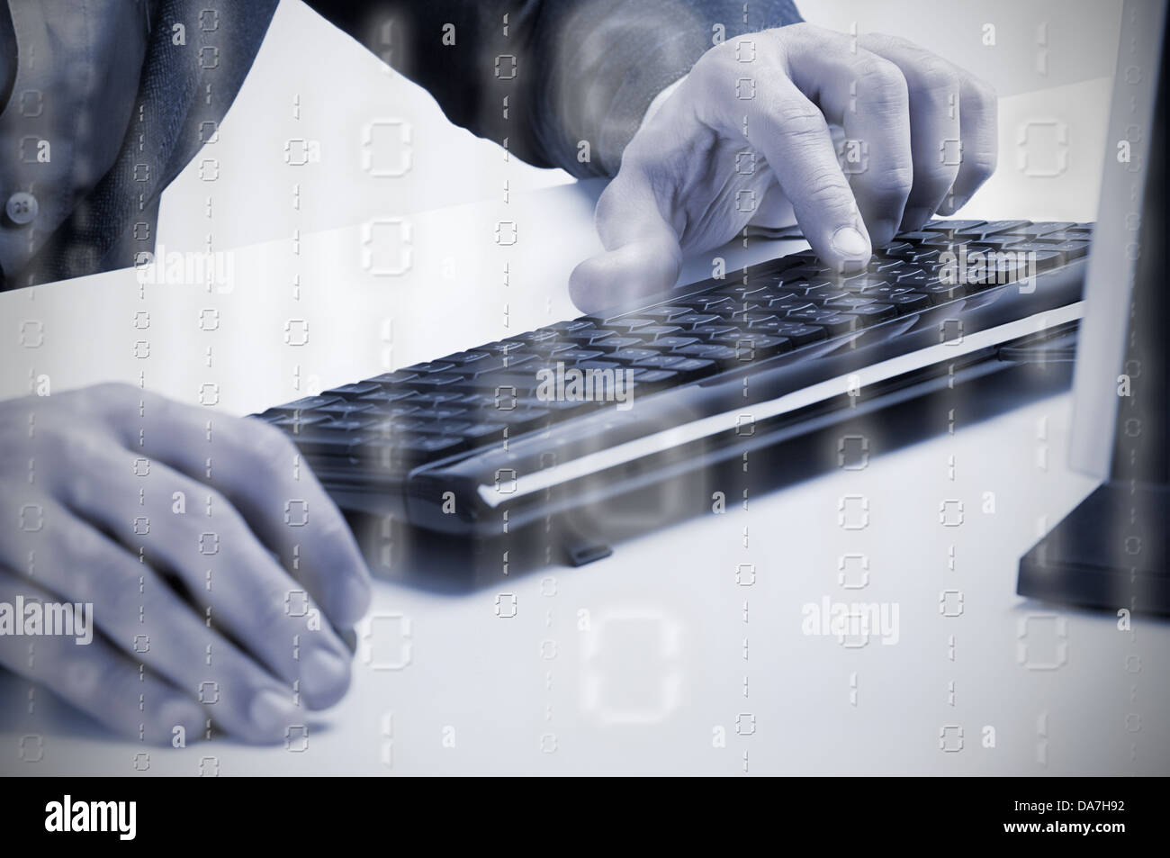 Businessman typing in a computer keyboard, blue tone, binary data overlay - Stock Image
