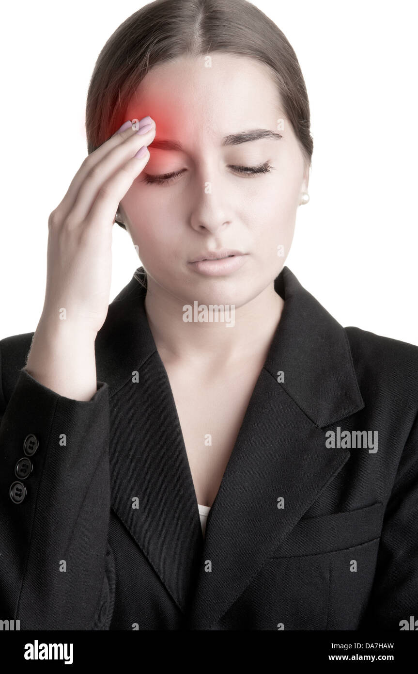 Business woman suffering from an headache, holding her hand to the head - Stock Image