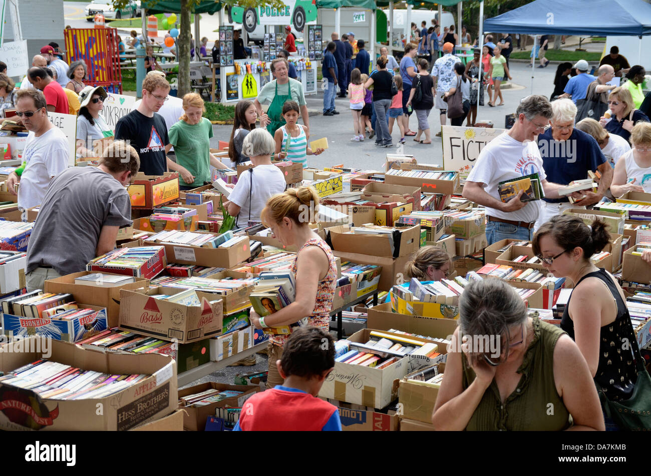 best loved 993bb 85db3 Dozens of shoppers shop at a large outdoor book sale in ...