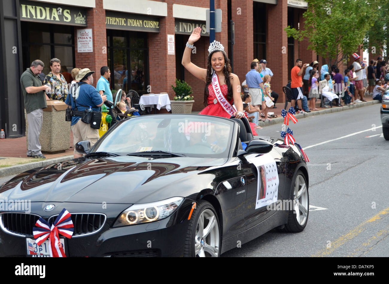 Destiny Welch Miss Maryland in Annapolis's July 4th parade waves at the crowds - Stock Image